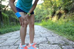 49955883 - woman runner hold her sports injured knee